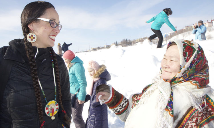 Dyani White Hawk Polk with the participant of the Reindeer Herders Festival (Photo belongs to the US Dept of State)