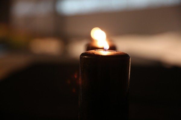 A remembrance candle lit at Holocaust commemorative event at the Jewish Museum and Tolerance Center