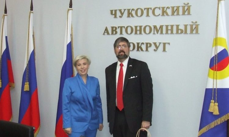 Woman and man stand, pose for a photo. (Photo by State Dept)