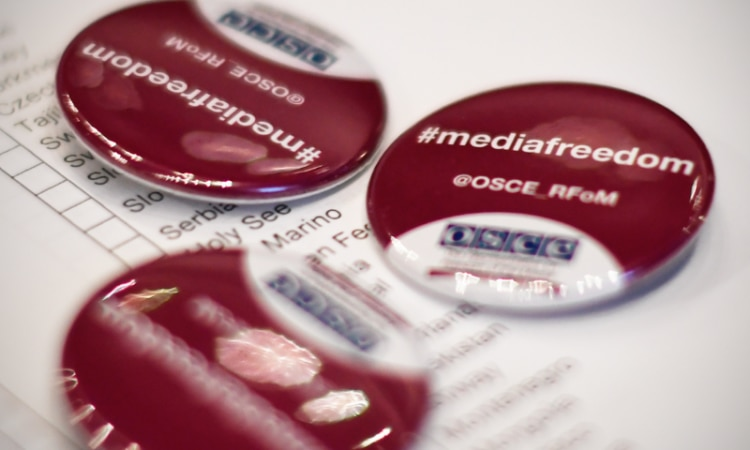 Badges promoting media freedom distributed by the OSCE Representative on Freedom of the Media, Dec. 1, 2016. (USOSCE/Colin Peters)